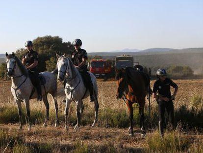 Police on horseback search for the missing US tourist near Castrillo de los Polvazares.