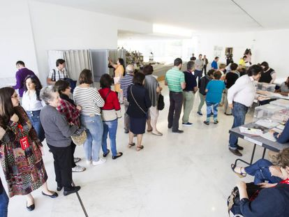 Voters lining up at a polling station in Santiago de Compostela.