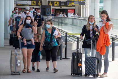 Travelers in Palma de Mallorca on June 13.