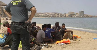 A group of migrants on the beach at the Spanish exclave of Melilla last week.