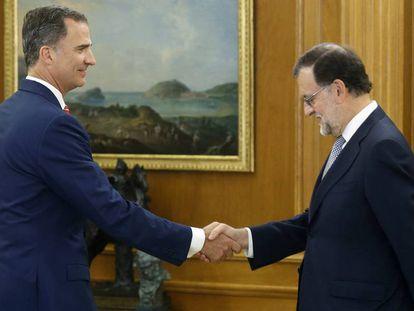 King Felipe greets Mariano Rajoy in July.
