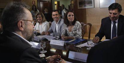 Ciudadanos and PP negotiators on Thursday.