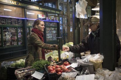 Sarolta Molnar buys groceries at Rákóczi Market in Budapest.
