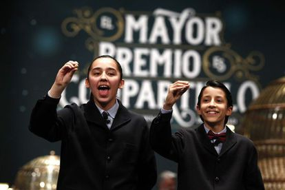 Children singing out El Gordo at the 2014 Christmas Lottery.
