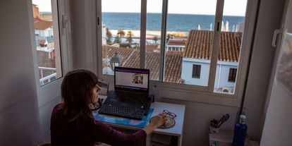 A woman works remotely from home during the coronavirus lockdown in Spain.