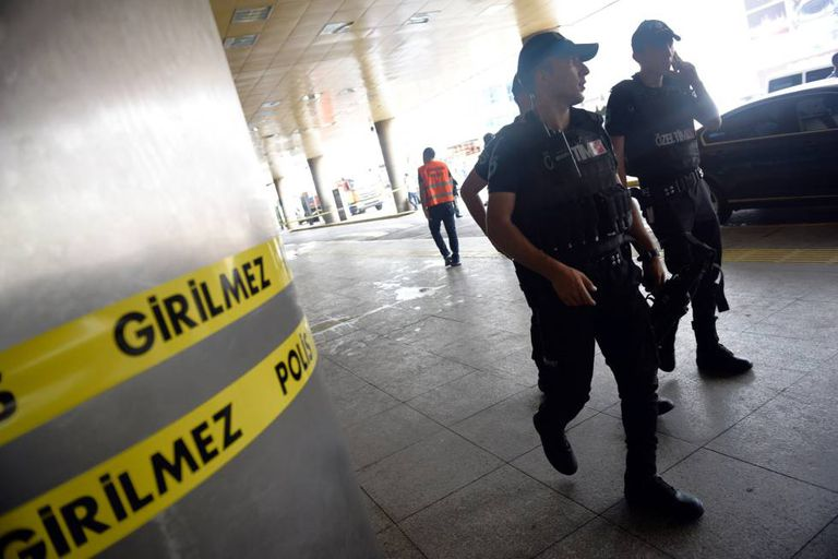 Security officials patrol outside Ataturk Airport in Istanbul on Wednesday.
