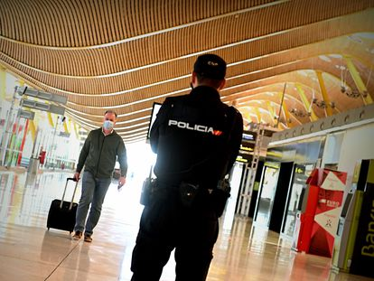 A police officer controls access to Terminal 4 at the Adolfo Suárez Madrid-Barajas airport after a state of alarm was declared in the region.