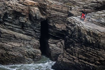 Tourists on the rocks in As Catedrais.