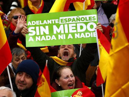 """Onward Spaniards – No fear of anything nor anyone,"" reads this banner held by a protester at Sunday's rally in Madrid."