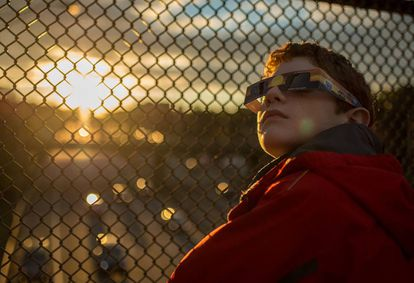 A child watches the last solar eclipse in the United States in 2014.