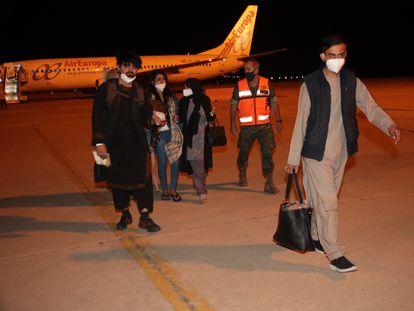 A group of Afghan evacuees arrives at the Torrejón de Ardoz air base in Madrid.