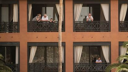 Guests on their balconies at the H10 Costa Adeje Palace hotel in the Canary Island of Tenerife.