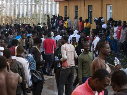 Would-be migrants gather in the courtyard of a temporary holding center in Melilla.