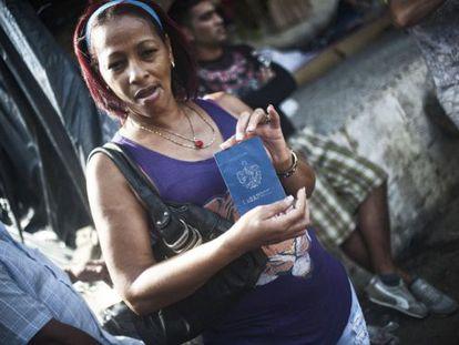 A Cuban migrant shows her passport at a shelter in La Cruz, Costa Rica.