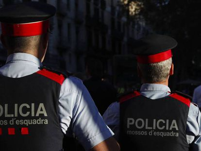 Two members of the Catalan police force.