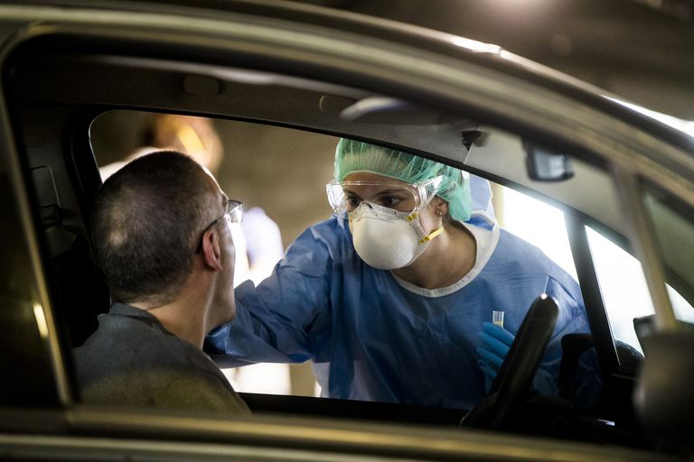 A health worker carries out a fast coronavirus test at a field hospital in Asturias.