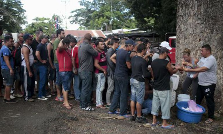 Cuban migrants line up for food at the Peñas Blancas border crossing between Costa Rica and Nicaragua.