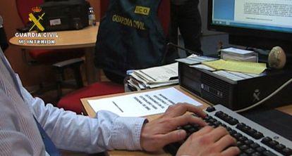Civil Guard officers investigating a virtual kidnap case.