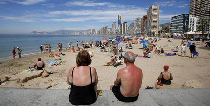 Tourists enjoying the beaches of Benidorm in September.