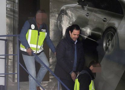 Miguel López in handcuffs following his arrest.