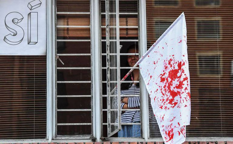 A white flag stained blood red after Colombia's referendum.