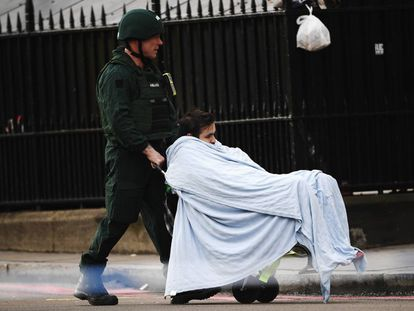 A medic moves the Portuguese man who was helped by Manuel Labrado after the attack.