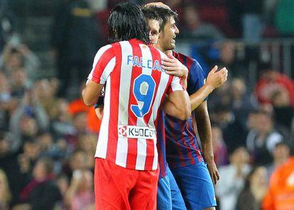 Leo Messi and Radamel Falcao embrace after a league match between Atlético and Barcelona.