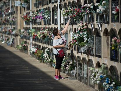 A woman places flowers in the Poblenou cemetery in Barcelona.