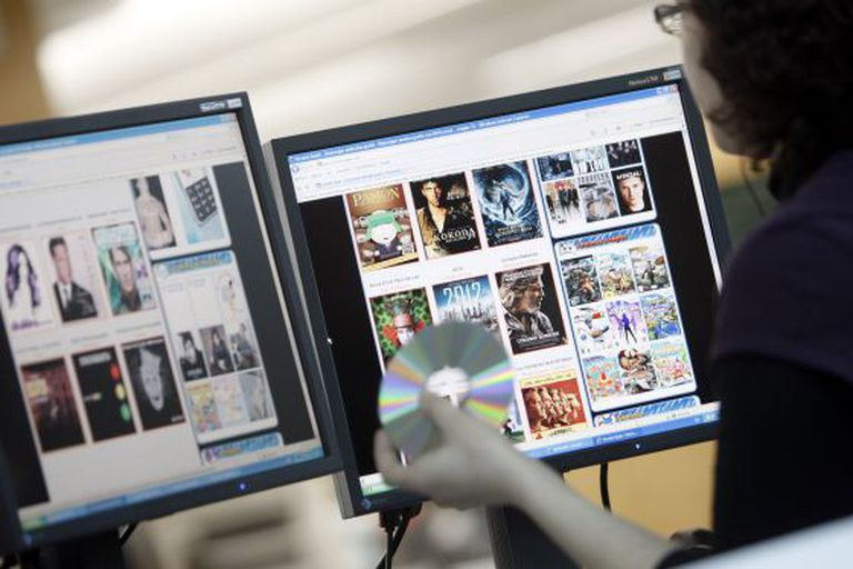 An internet user looks at webpages offering file downloads.