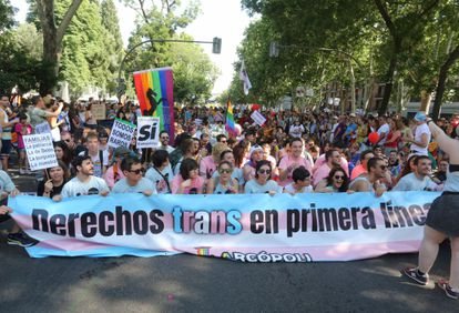 """A banner reads """"trans rights on the front line"""" at Madrid's Pride parade in 2018."""