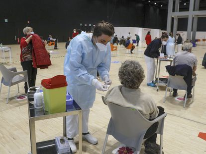 People receiving a dose of the AstraZeneca vaccine in Rome, Italy.