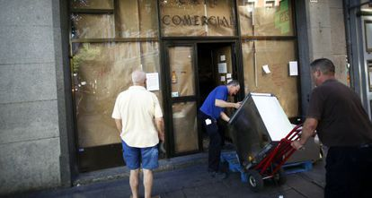 Employees taking items out of Café Comercial after it closed in late July.