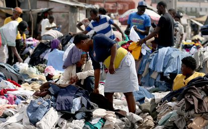 Haitians buy clothes at a street market on Sunday.