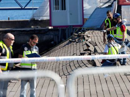 Police investigate the collapsed promenade.