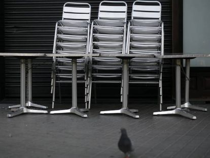 Chairs and tables outside a closed bar in Barcelona today.