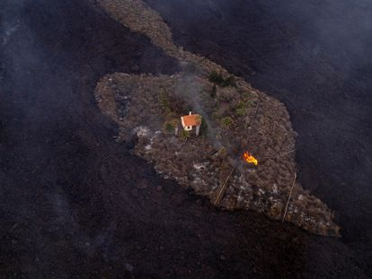 A house that escaped the advancing lava in Las Manchas on Monday.