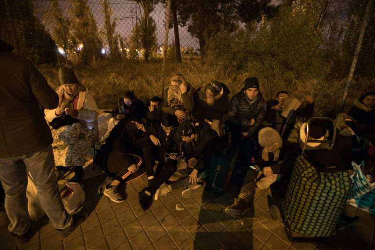 People sleep on the street to be able to request asylum in Madrid.