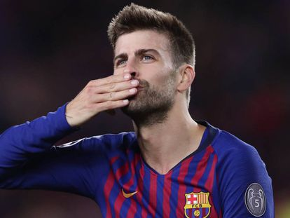 Piqué gestures to fans after the Barcelona-Liverpool match.