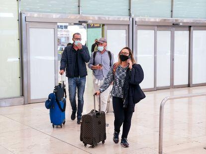 Passengers arrive this week in Madrid's Barajas Airport.