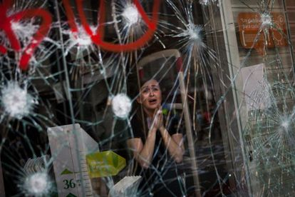 The award-winning photograph of a woman inside a Barcelona store during a protest to mark the March 2012 general strike.