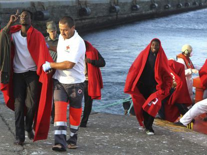 Immigrants arriving in Spain at Tarifa, Andalusia in the care of the Red Cross.