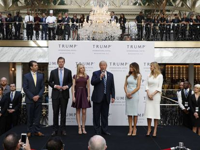 Trump with his wife and children at the inauguration of his Washington hotel in October.