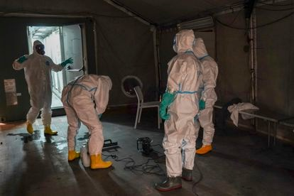 Members of the Emergency Military Unit disinfect the showers of the Ifema shelter.