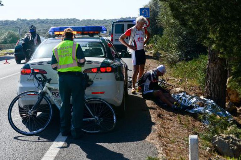 Cyclists and a civil guard beside the body of the 64-year-old German tourist run over in Mallorca on Sunday.