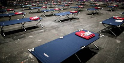 A temporary homeless shelter has been created at the Ifema trade fair facility in Madrid.