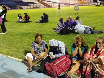 Residents of Iquique wait to be taken to safety after they abandoned their homes on Tuesday night.