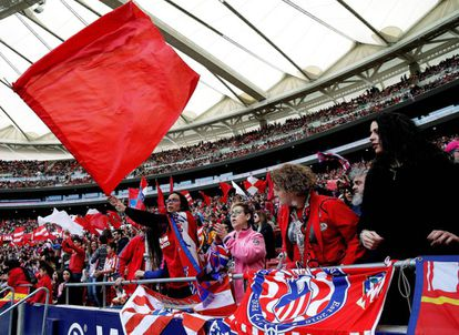 Atlético fans wave flags during the match.