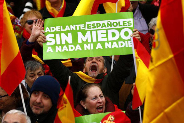"""""""Onward Spaniards – No fear of anything nor anyone,"""" reads this banner held by a protester at Sunday's rally in Madrid."""