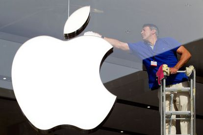 """An employee cleans the Apple symbol at one of its Spanish stores. Apple is said to have discovered """"the Holy Grail of tax avoidance."""""""