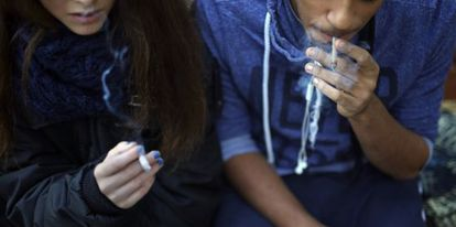 A 15-year-old girl smokes alongside her 17-year-old friend in Madrid.